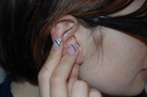 Ohren massieren